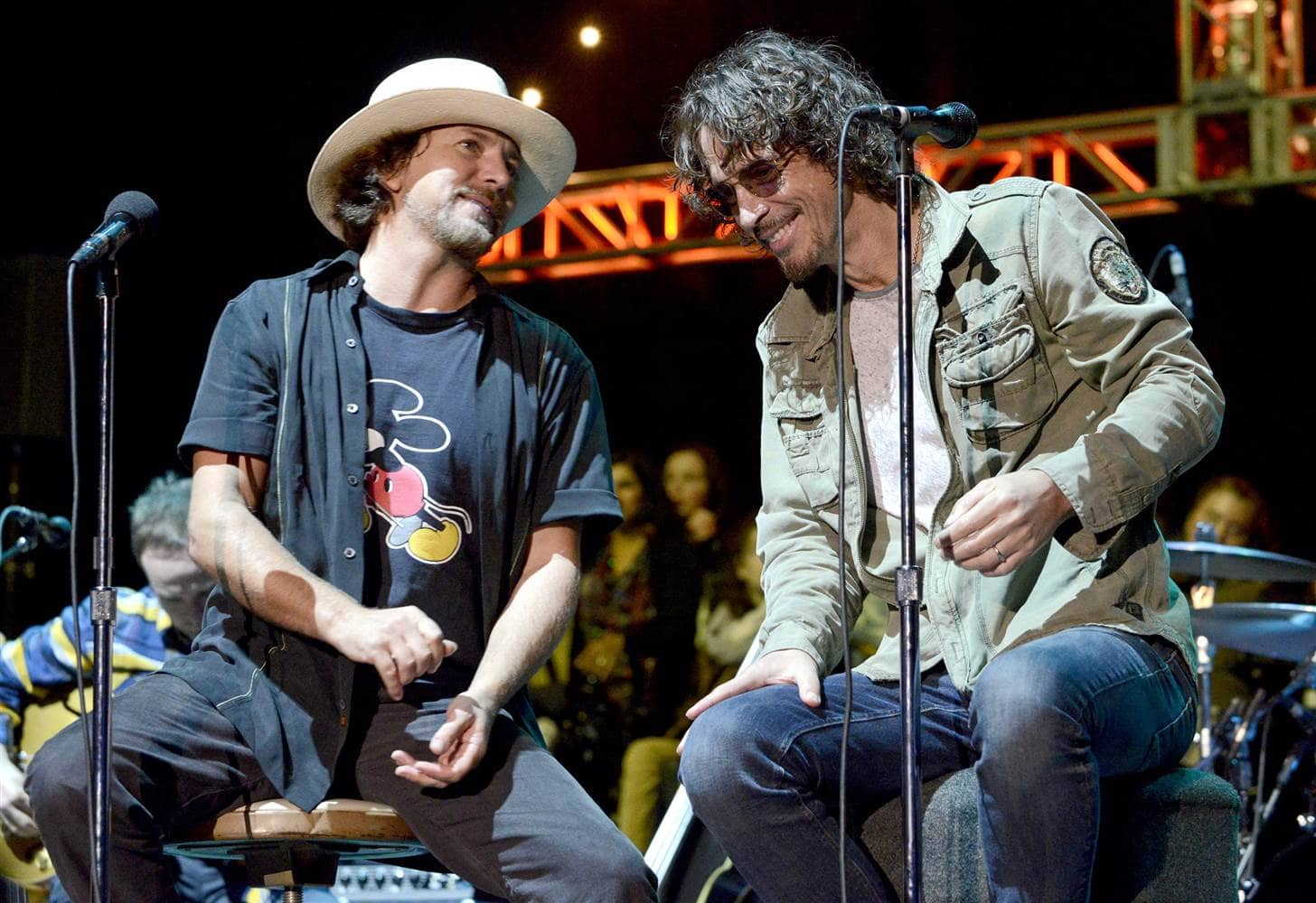 Eddie Vedder and Chris Cornell smiling together on stage